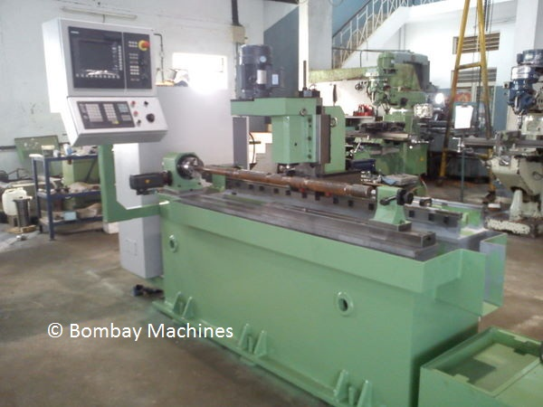 CNC GROOVE MILLING MACHINE FOR ROLLERS